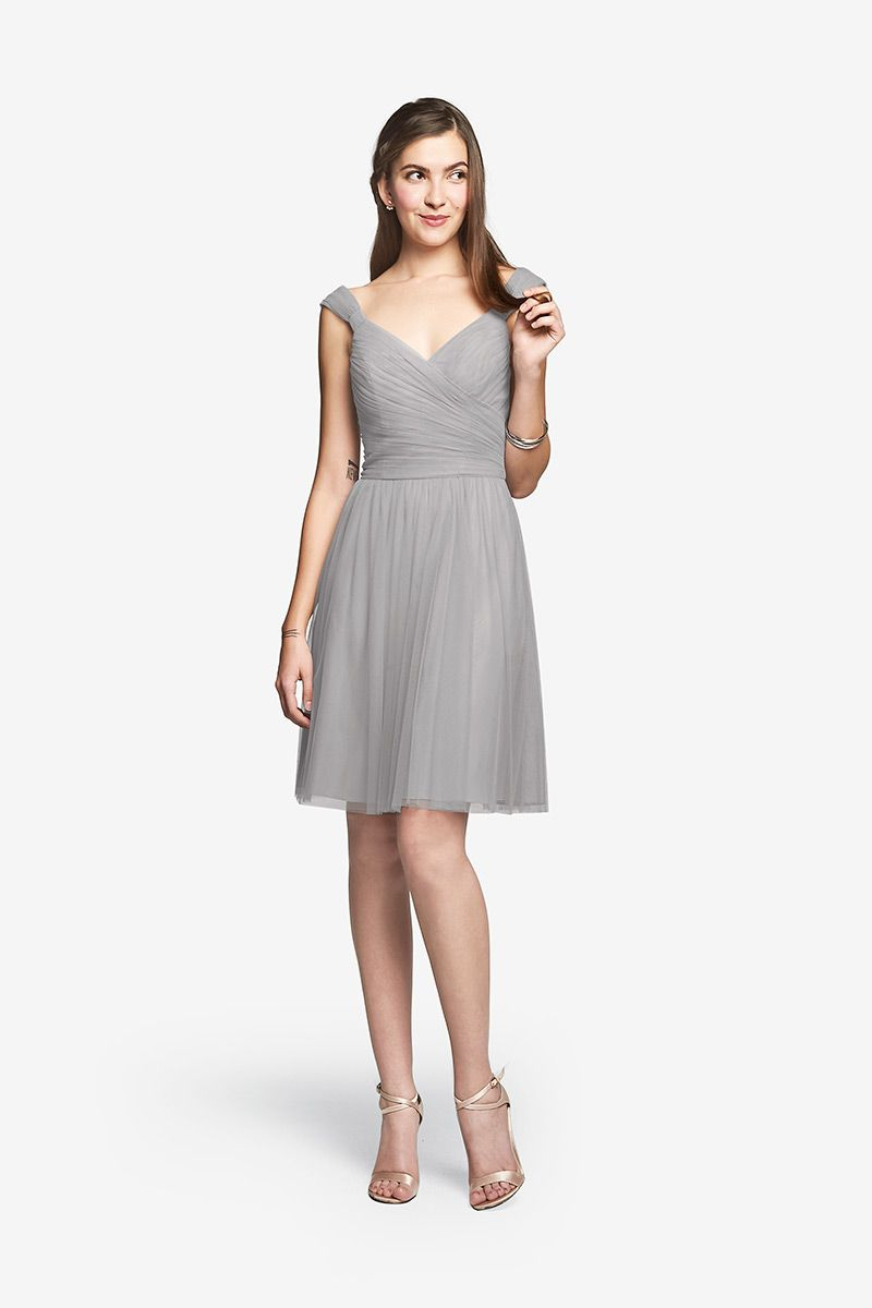 Lake Dress Wide Neck Dress in Tulle Even though our dress is made from tulle, there's a structured quality to it, courtesy of the way our knotted shoulder straps frame the shoulders to the fitted torso and more relaxed drape below. We also love its versatility—dressed up or down, it's perfect every time.