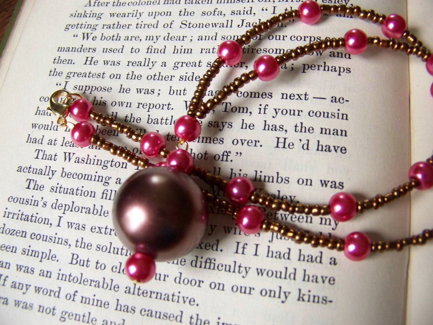 I'm not a pink girl, but there's something about this I just LOVE!    Out of the Silent Planet necklace Inspired by the novel by C.S. Lewis. $17.50, via Etsy.