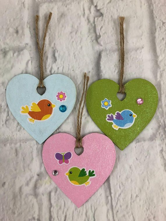 set of 3 wooden heart shaped ornaments pink green and blue