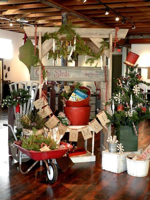 Exceptional Christmas Craft Booth Ideas Part - 14: Holiday Display - Red Buckets, Wooden Urns And A Wheelbarrow.