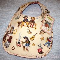 Cute to Boot! Reversible, western print baby bib. Featuring cowboys and cowgirls. Thick and absorbent.