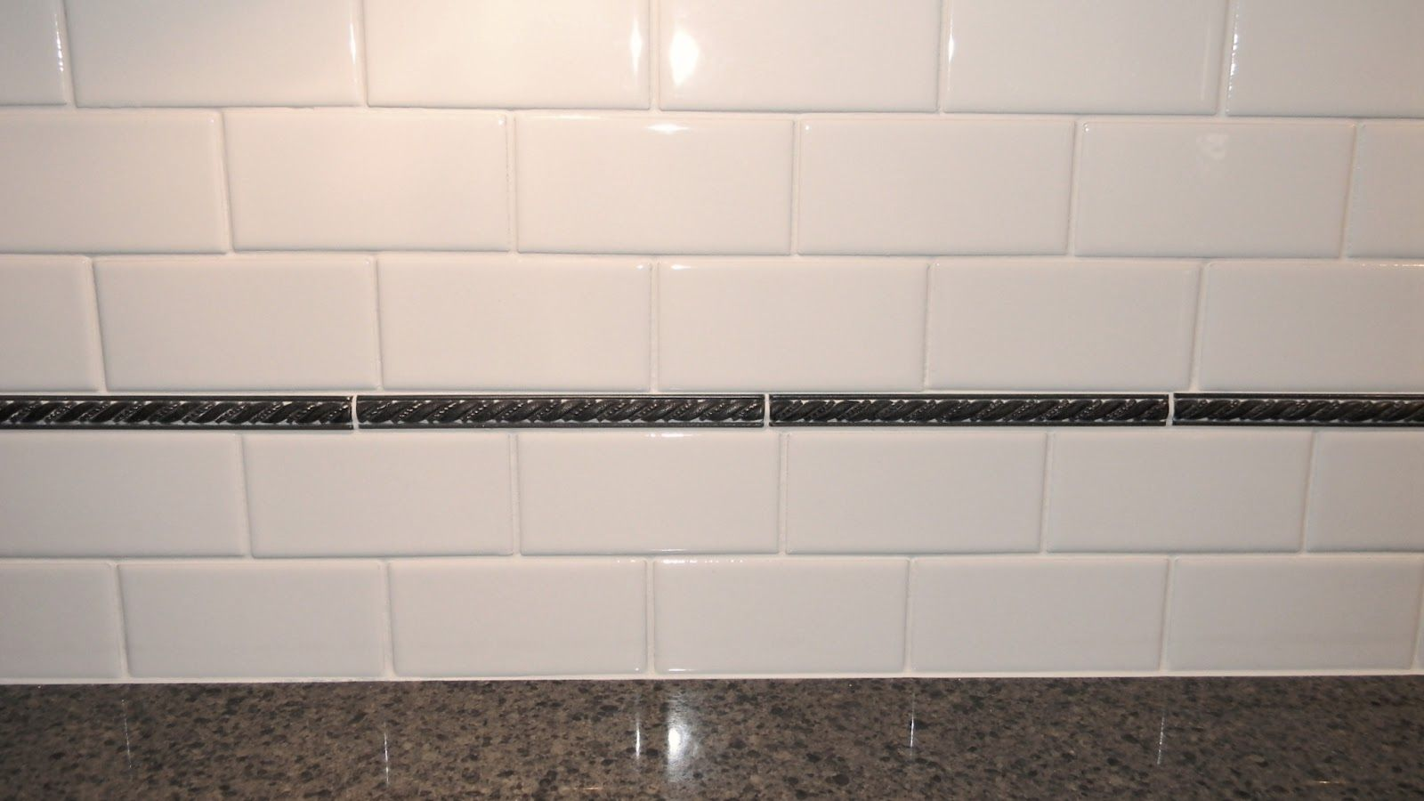 dramatic kitchen make-over - white subway tile and black pencil
