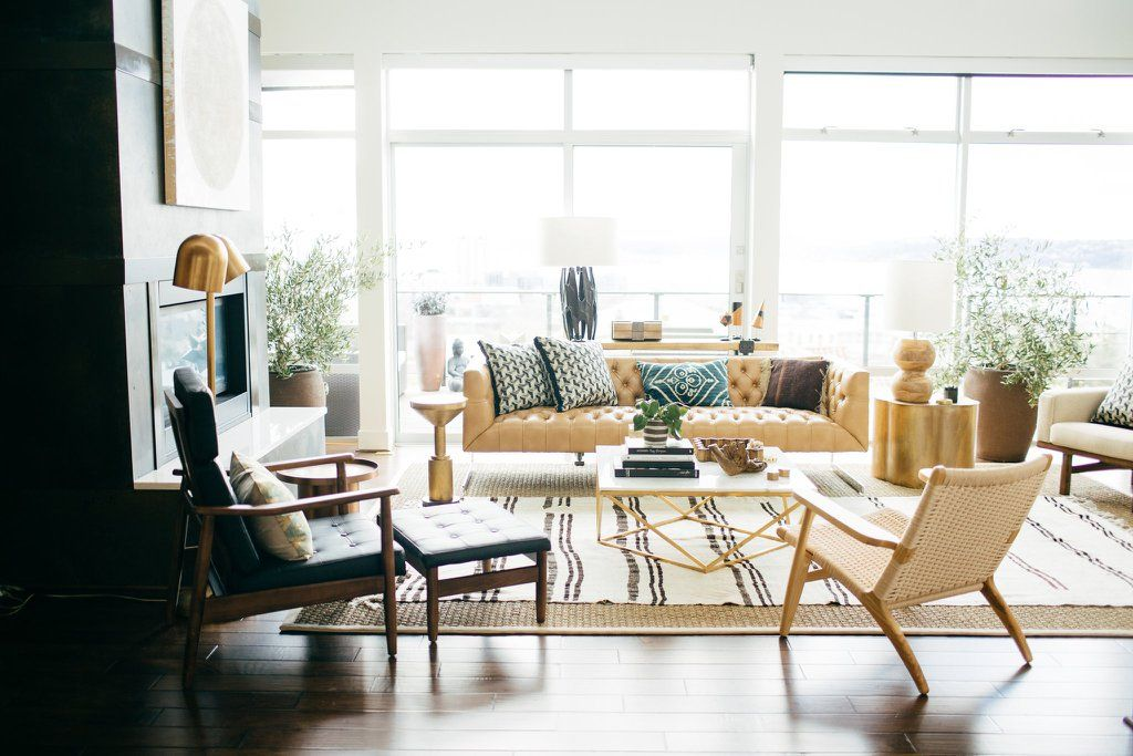 8 Fall Decorating Trends That Add a Wow Factor Layering rugs