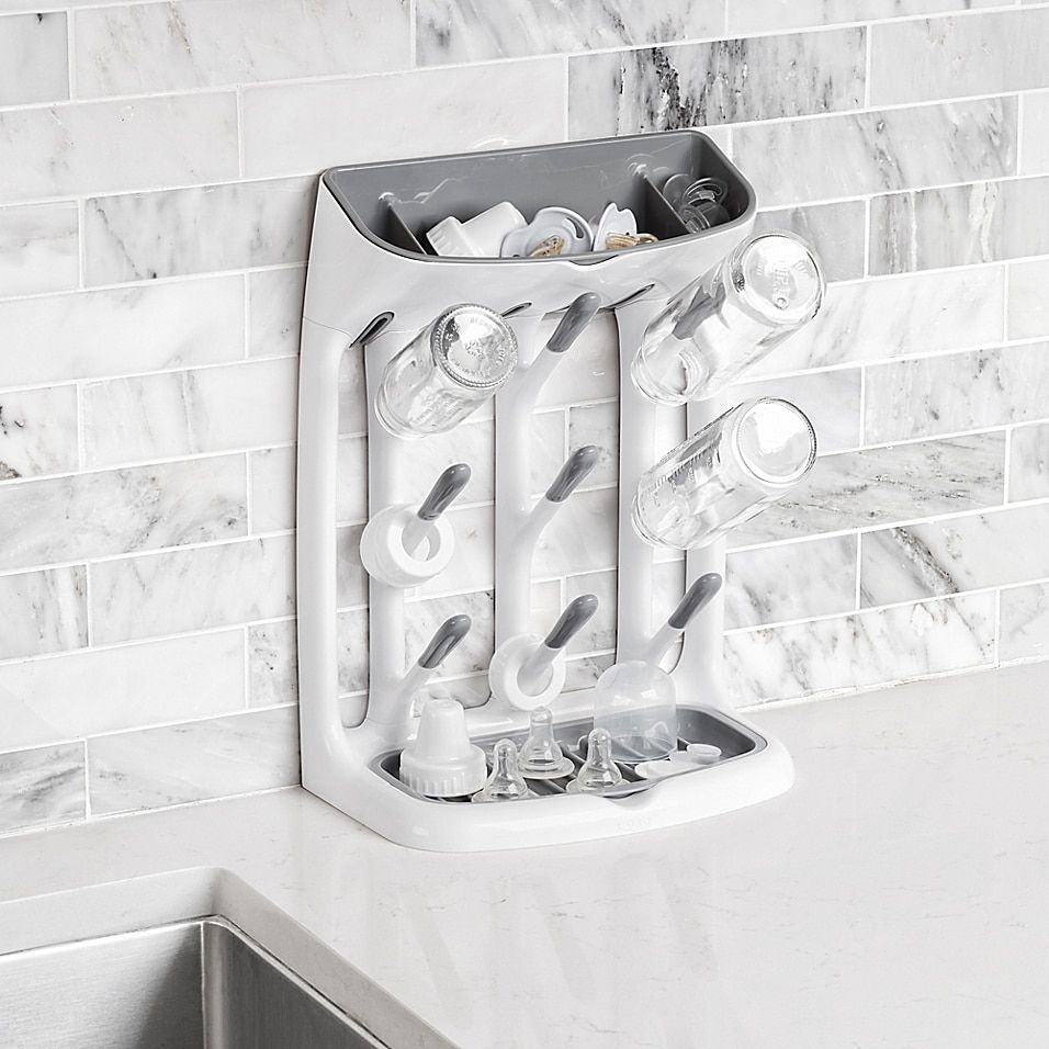 OXO Tot Space Saving Drying Rack In Grey - Use the OXO Tot Space Saving Drying Rack to dry baby bottles and sippy cups without taking up too much space. Compact design features 9 angled hooks for bottles and cups plus a removable top compartment for covers, nipples, and other small items.