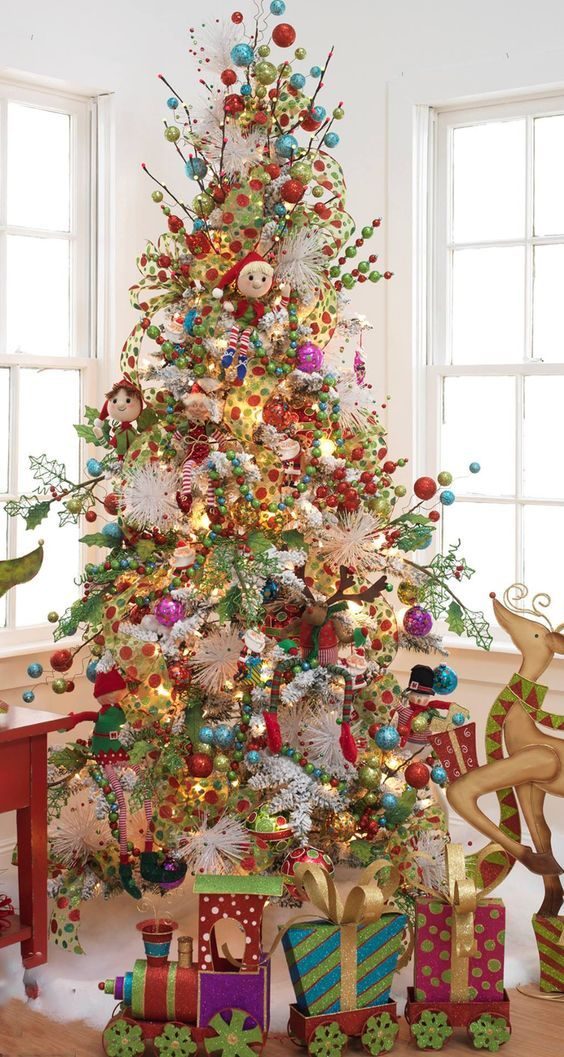 A Super Bold Whimsical Tree Decorated With Toys And Ornaments Whimsical Christmas Trees Colorful Christmas Tree Decor Colorful Christmas Tree