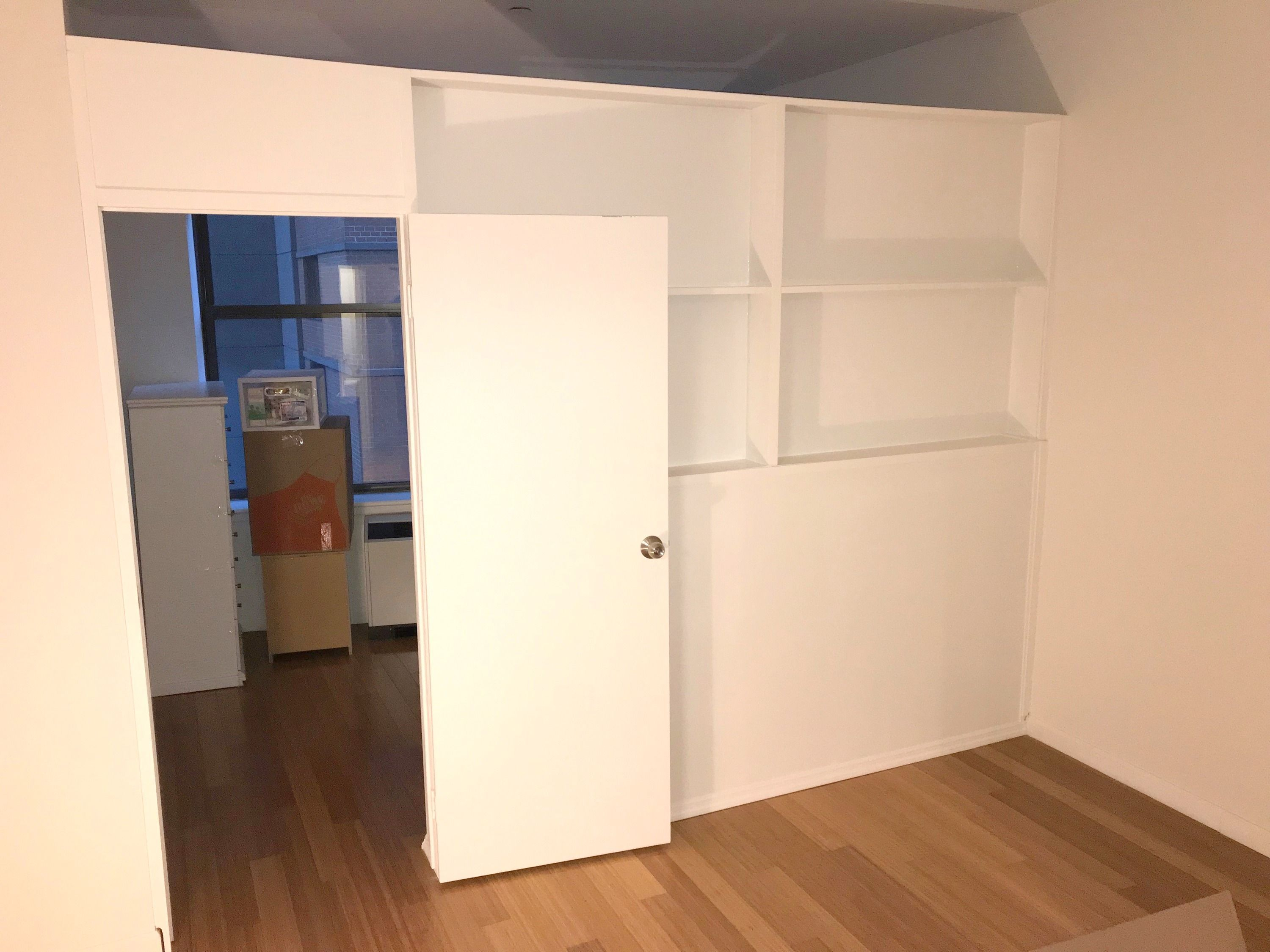 Custom Temporary Partition With Bookcase Call Us For All Your Custom Room Partition And Storage Wall Inquiries Bookcase Wall Diy Room Divider Bedroom Redesign