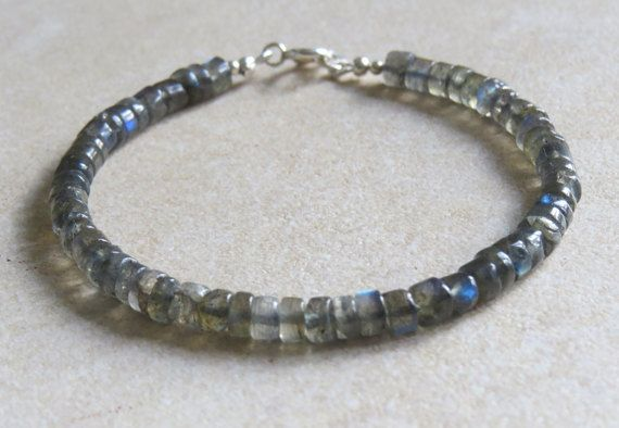 This is a fairly unisex bracelet made with tube beads measuring 4x3mm. The Labradorite has some beautiful flashes of blue that I hope you can see in the photos. The bracelet measures 7 inches with a sterling silver lobster claw clasp. The length can be adjusted if required.