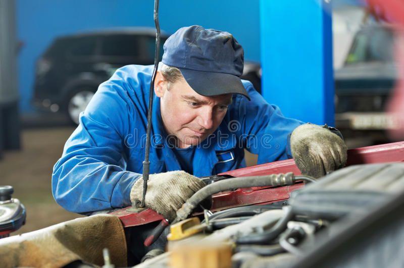 Car mechanic diagnosing auto engine problem. Motor mechanic diagnosing automobil ,