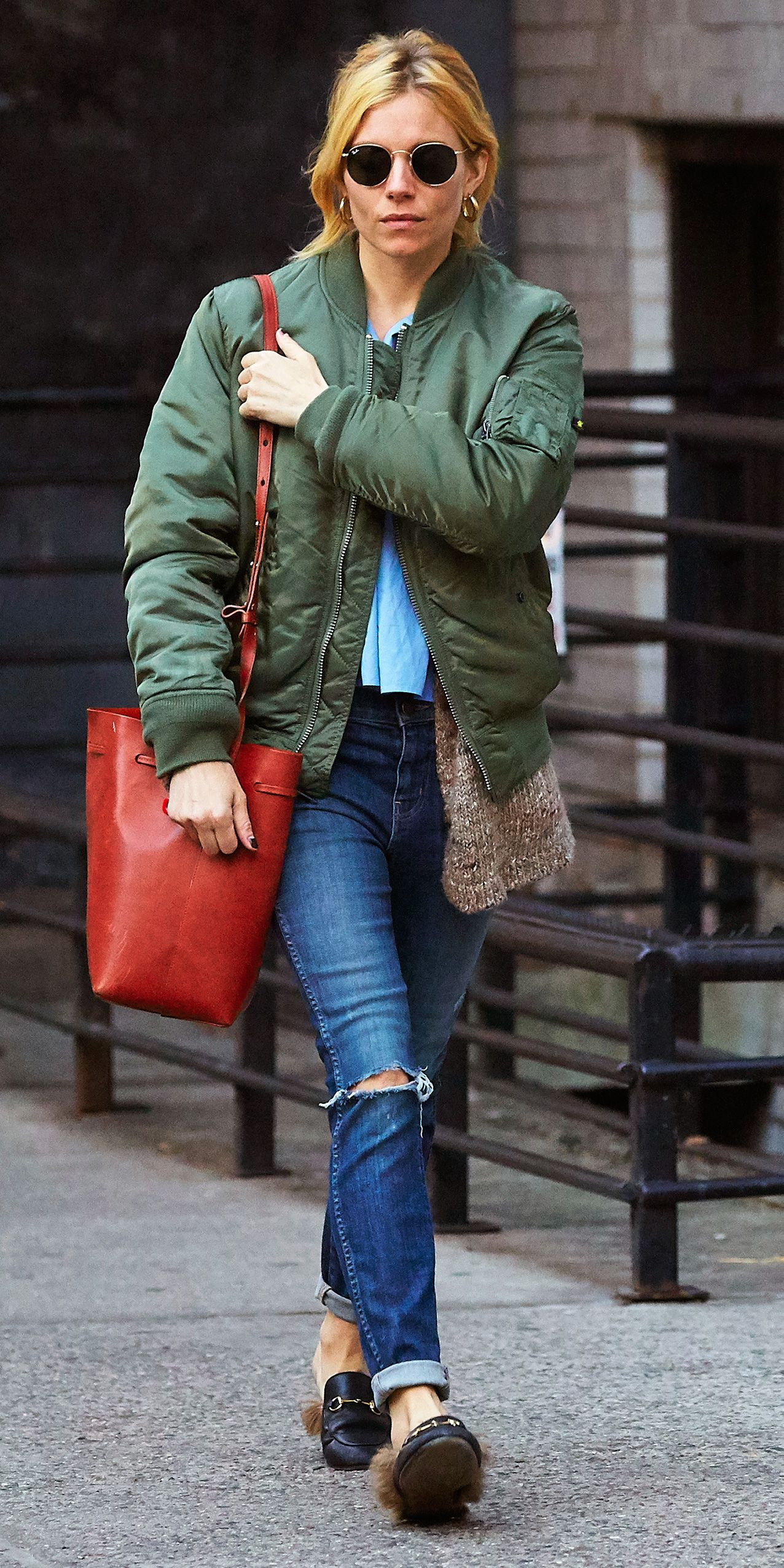 d9aa35f197f Sienna Miller wore her bomber with furry loafers and distressed jeans.  Sienna Miller Style
