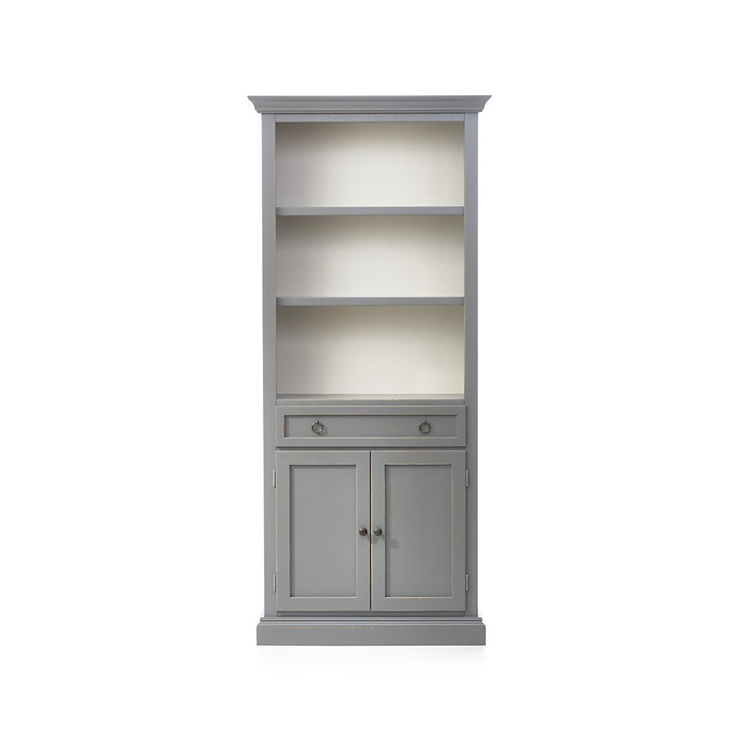 Shop cameo grey storage bookcase the storage bookcase with two shelves and an enclosed cabinet with drawer for games remotes and dvds combines with the
