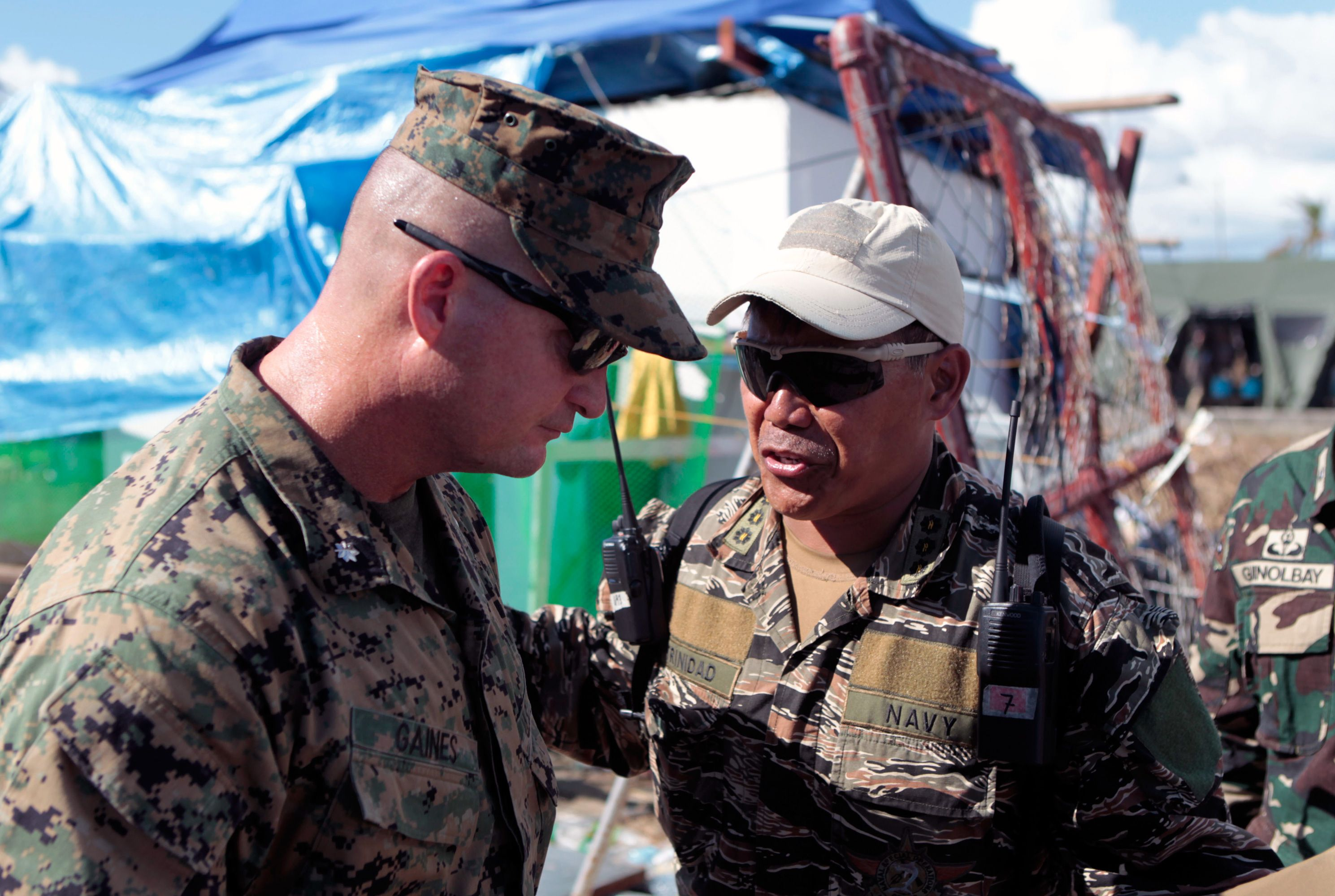 Philippines Navy Capt. Vincent Trinidad, right, and U.S. Marine Lt. Col. Travis T. Gaines speak Nov. 18, 2013, at Tacloban, Republic of the Philippines. At the request of the Government of the Philippines, U.S. military members have been providing support to the Armed Forces of the Philippines as part of Operation Damayan following Typhoon Haiyan. (U.S. Marine Corps photo by Cpl. Adam B. Miller/Released)