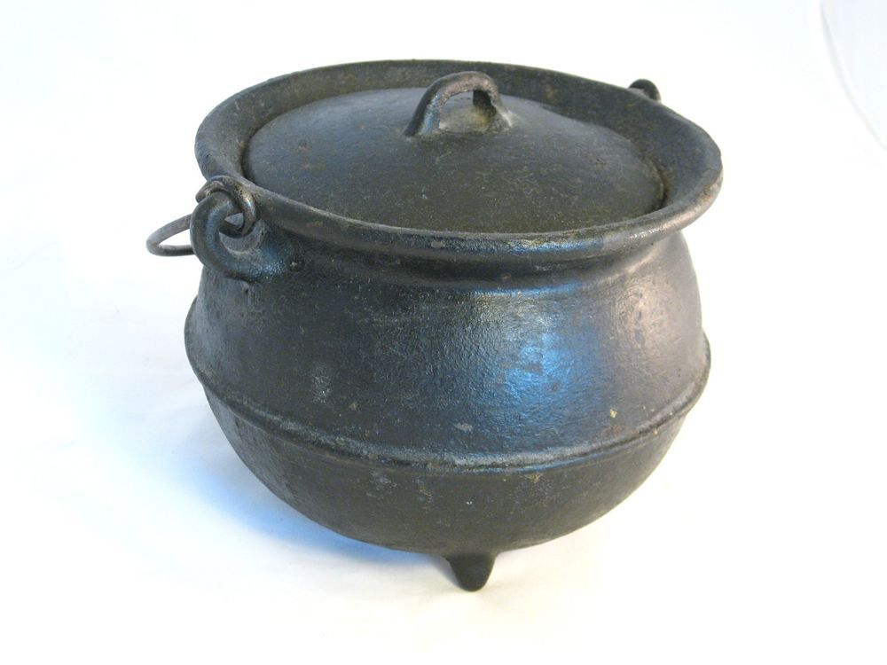 Antique cast iron ribbed 3 footed pot with lid and handle