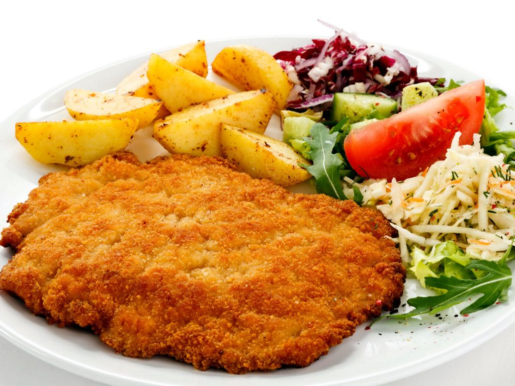 Kotlet schabowy [ˈkɔtlɛt sxaˈbɔvɨ] is a Polish variety of pork breaded cutlet coated with breadcrumbs similar to Viennese schnitzel,but made of pork tenderloin (with the bone or without), or with pork chop. There's also the Polish variety of the chicken breast cutlet  Just try it because is special.....