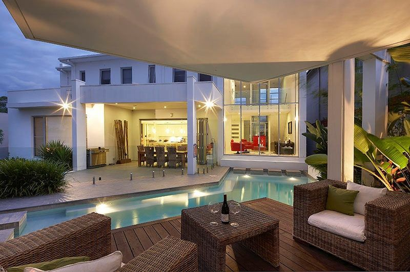 modern house sitting area interior design custom pool area undercover patio lounge with view to