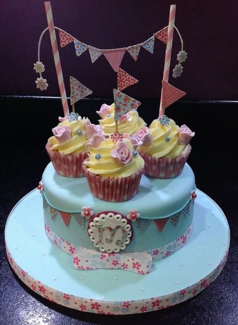 Cake With Cupcakes On Top