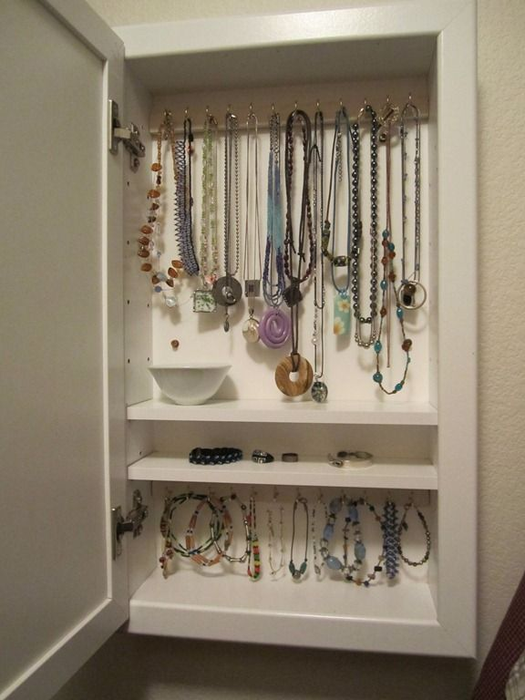 DIY Medicine Cabinet Turned Into A Mounted Jewelry Cabinet.