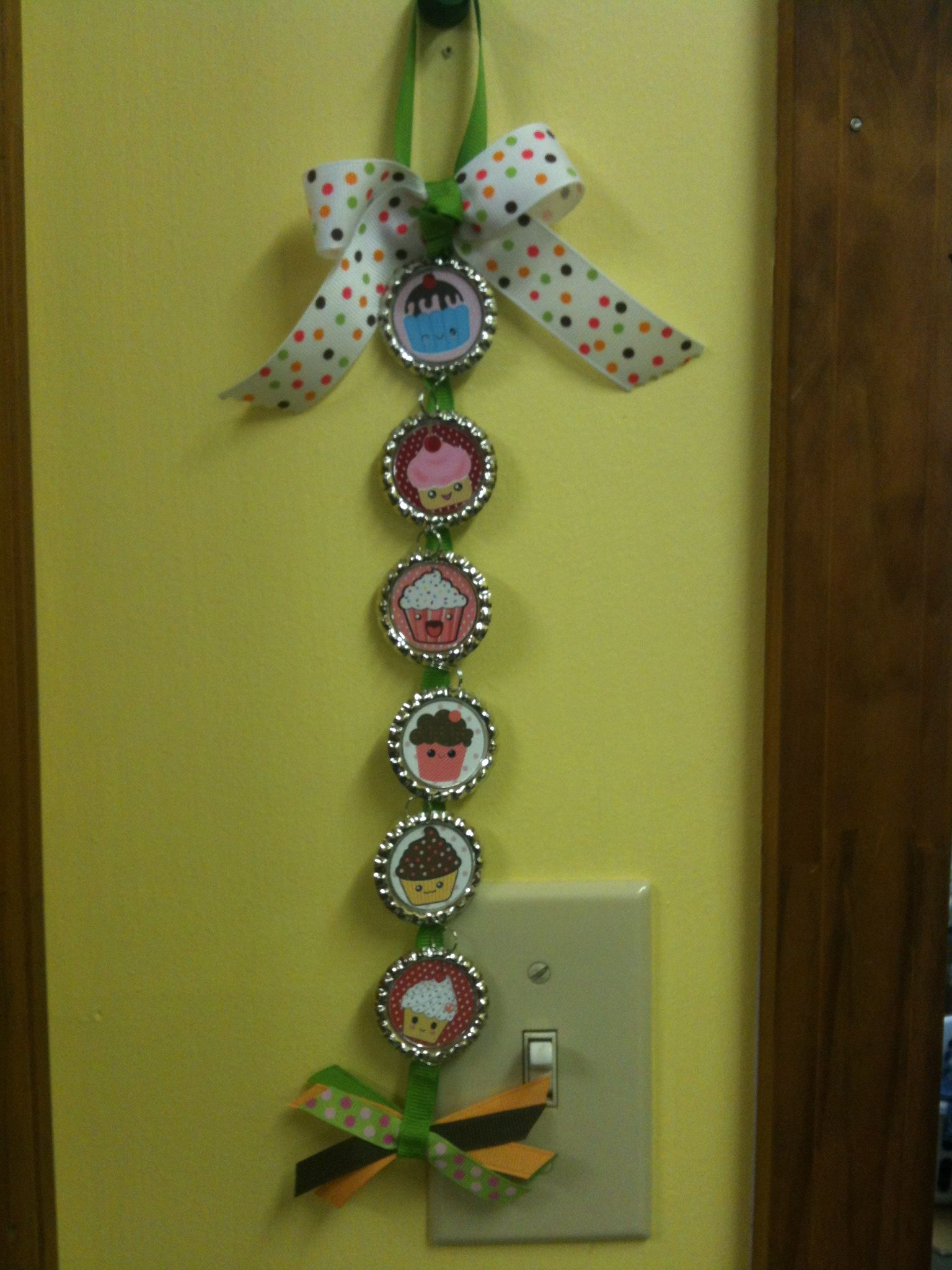 This is a cupcake wall decoration I made as a gift for a local ...