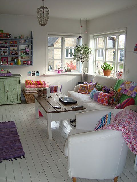 Rustic bohemian chic apartment with bright pops of color against white.  living here would make me happy. :)
