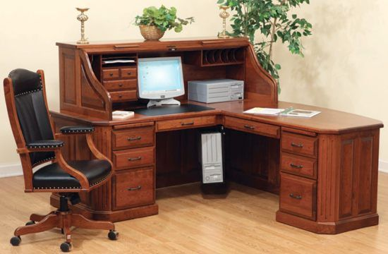 Gorgeous corner desk with roll top. Lots of working & storage space.