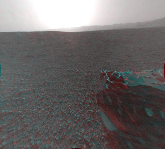 Mars in 3D - This image is a 3-D view behind NASA's Curiosity rover. The anaglyph was made from a stereo pair of Hazard-Avoidance Cameras on the rear of the rover and released Aug. 7.  CREDIT: NASA/JPL-Caltech