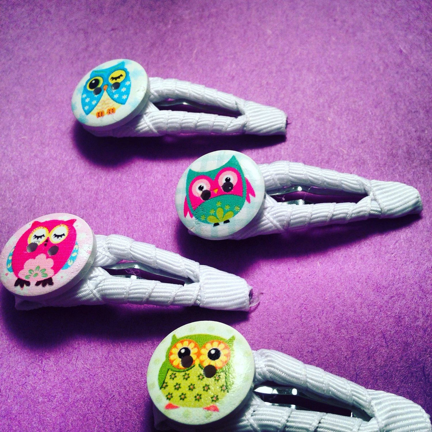 A personal favorite from my Etsy shop https://www.etsy.com/ca/listing/251894595/set-of-4-hair-clips-with-owl-buttons
