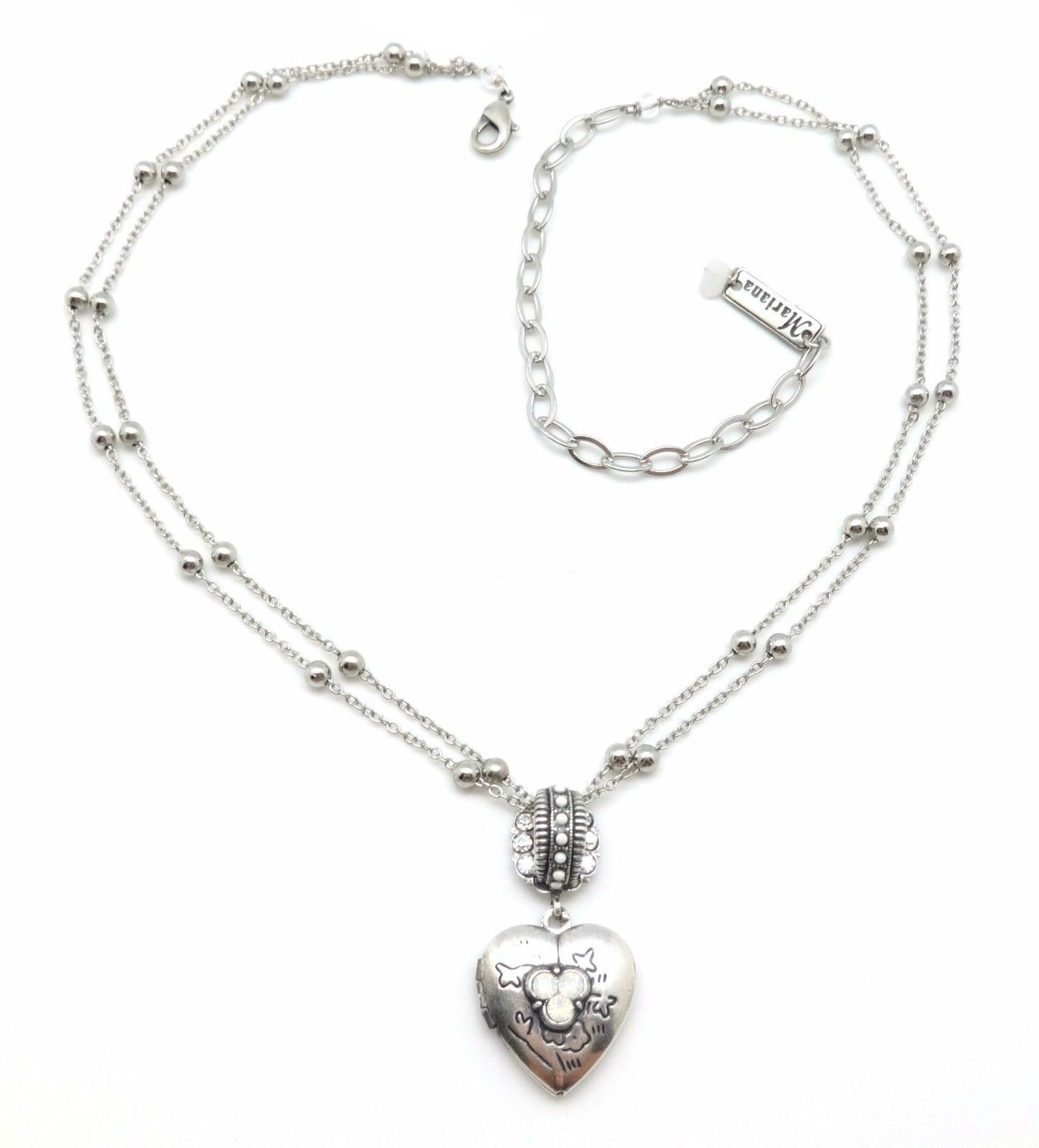 """Mariana Silver Plated Forever White Swarovski Heart Locket Necklace 5087. Silver Plating over Brass, Nickel Free / Hypo-Allergenic. Beautiful mix of Swarosvki Crystals in White Opalescent, Crystal Moonlight and White Opaque - Color 5087 """"Forever"""". Adjustable Silver Plated Double Strand Link Chain is Approximately 15"""" - 19"""" in length. Heart Locket is Approximately 3/4"""" wide by 1 1/2"""" long, removable from chain. Handmade, Lifetime Guarantee comes in Gift Box with Mariana Storage Pouch and..."""
