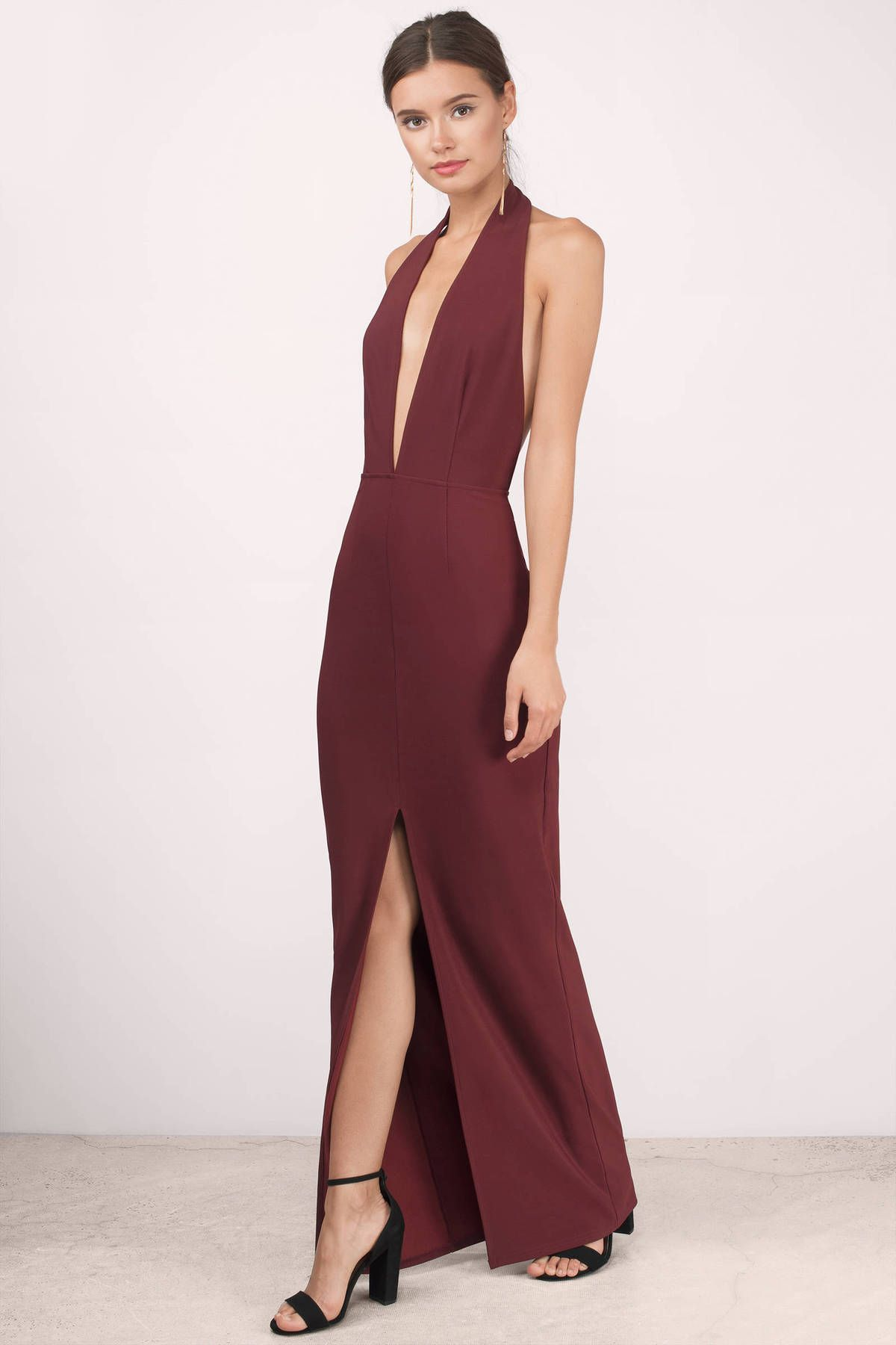 dda5e81a2a Turn heads with the Gala Deep Neck Maxi Dress. Featuring a halter plunging  neckline and backless maxi dress. Pair with heels and sta