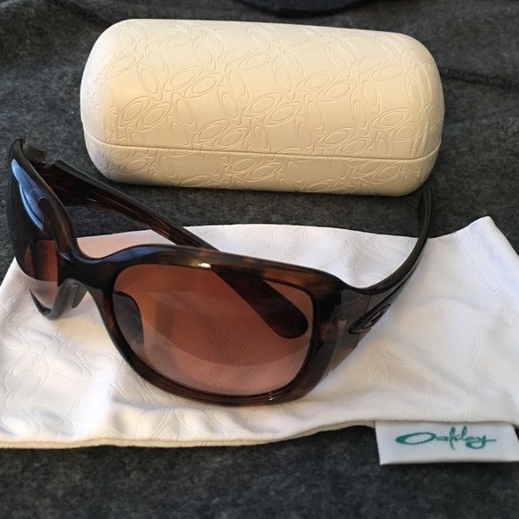 908e85cb3cb Women s Oakley Sunglasses Never worn women s sunglasses! Style name   Necessity. Color  brown tortious. Non-polarized. Sides can snap on and off    durable!