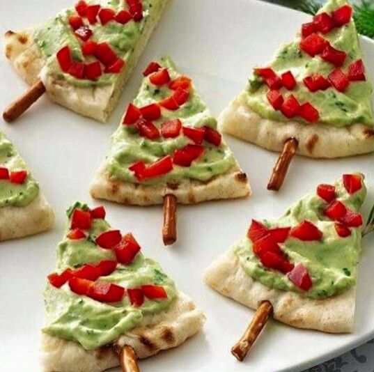 Pitta Bread Christmas Trees. Pitta bread triangles with Guacamole, red pepper 'decorations' and a pretzel stick for the tree trunk. ☆