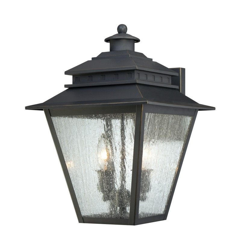 The Quoizel Weathered Bronze Outdoor Sconce is part of the Carson Collection