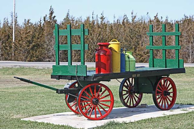 Vintage milk cans on antique railway baggage cart for Railroad stations for sale