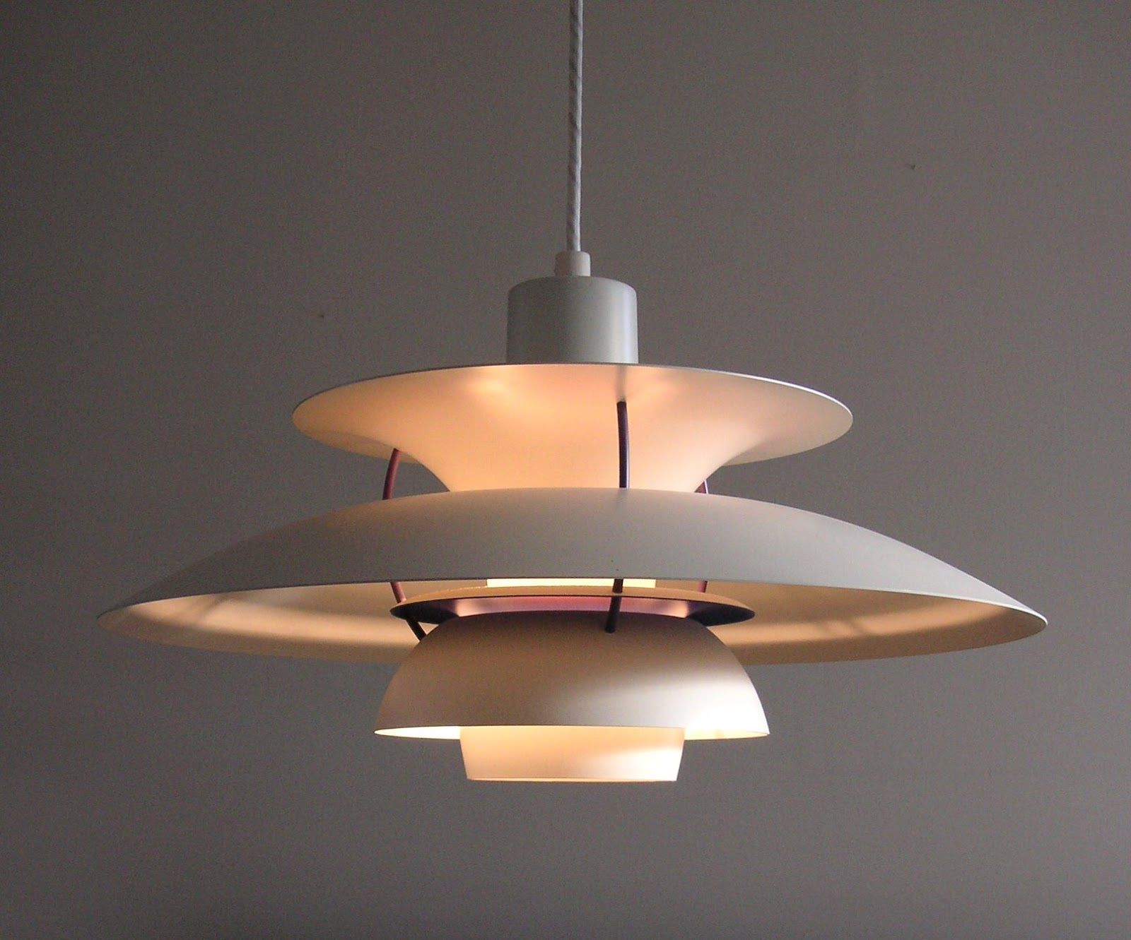 modern dining room light fixture with unique shape of three level