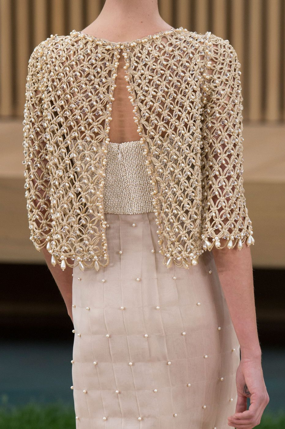 Intricate delicate beading at chanel for Haute couture seamstress