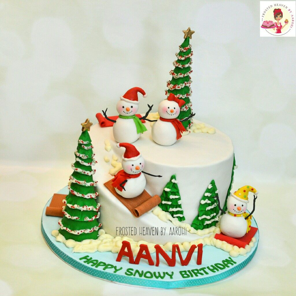 A White Winter Theme Cake With Playful Snowmen And Christmas