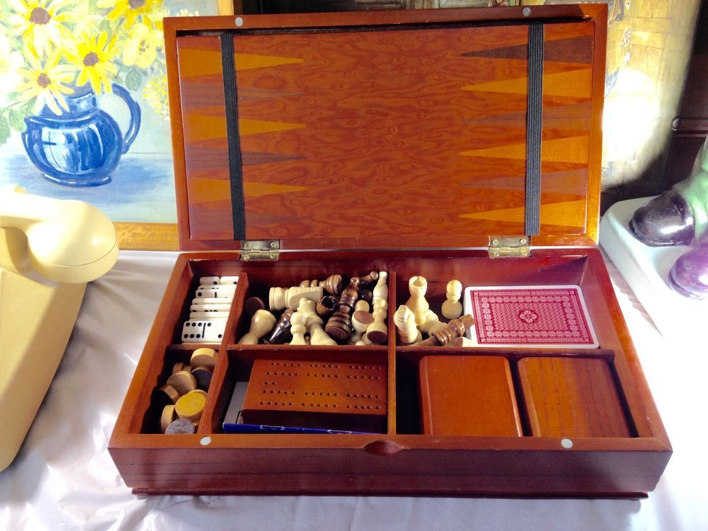 To use at home or to travel, this box will give your a choice of what to, Chess, Draughts, Backgammon,Dominoes and Cribbage, or any other Card game. The pieces are intact, the box has some age related wear but not much. The box measures approximately 32.5cm x 17.5cm x 8cm, The Chess Board measures approximately 30cm x 30cm, the Backgammon Board is on the reverse of the Chess Board, The Dice Shakers measures approximately 6.5cm x 6.5cm x 3.5cm, The Cribbage Board measures approximately 8.5cm…