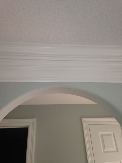 Triple crown molding completes this elegant dinging area