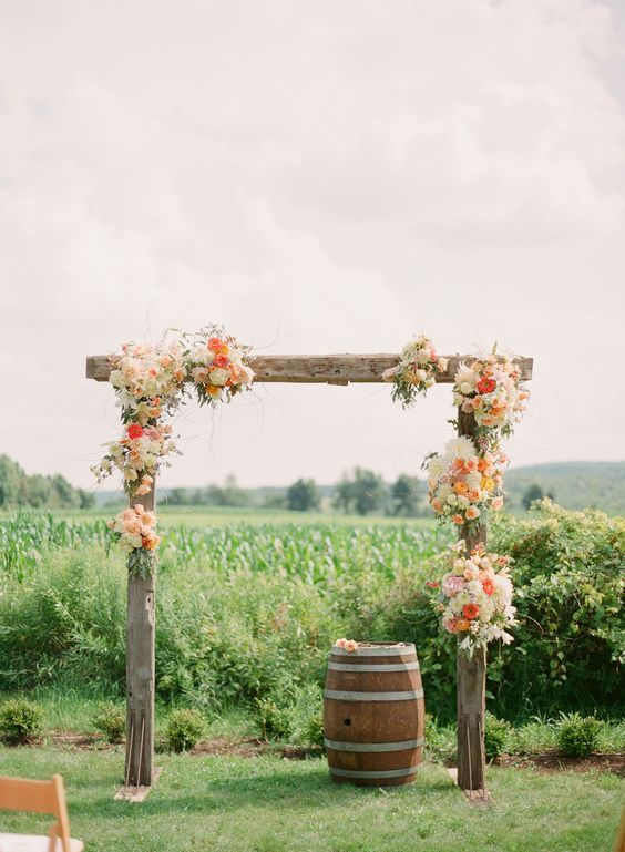 27 rough wood wedding arch topped with flowers   Weddingomania