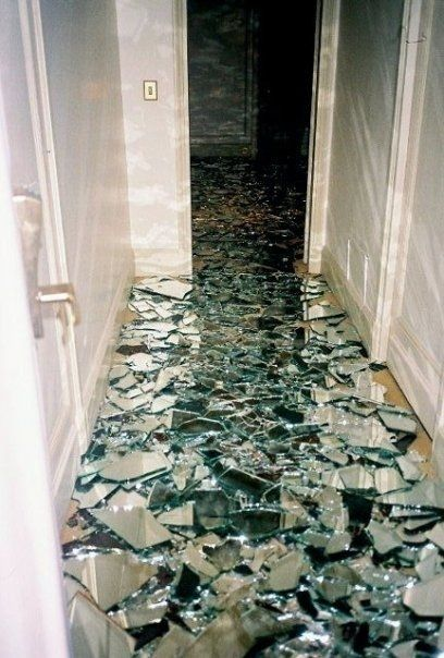 this is cool ... Lay a mirror down, take a hammer to it, pour polyurethane over — Amazing bathroom floor — or could do for a desk top.. or coffee table..WALKING ON BROKEN GLASS.