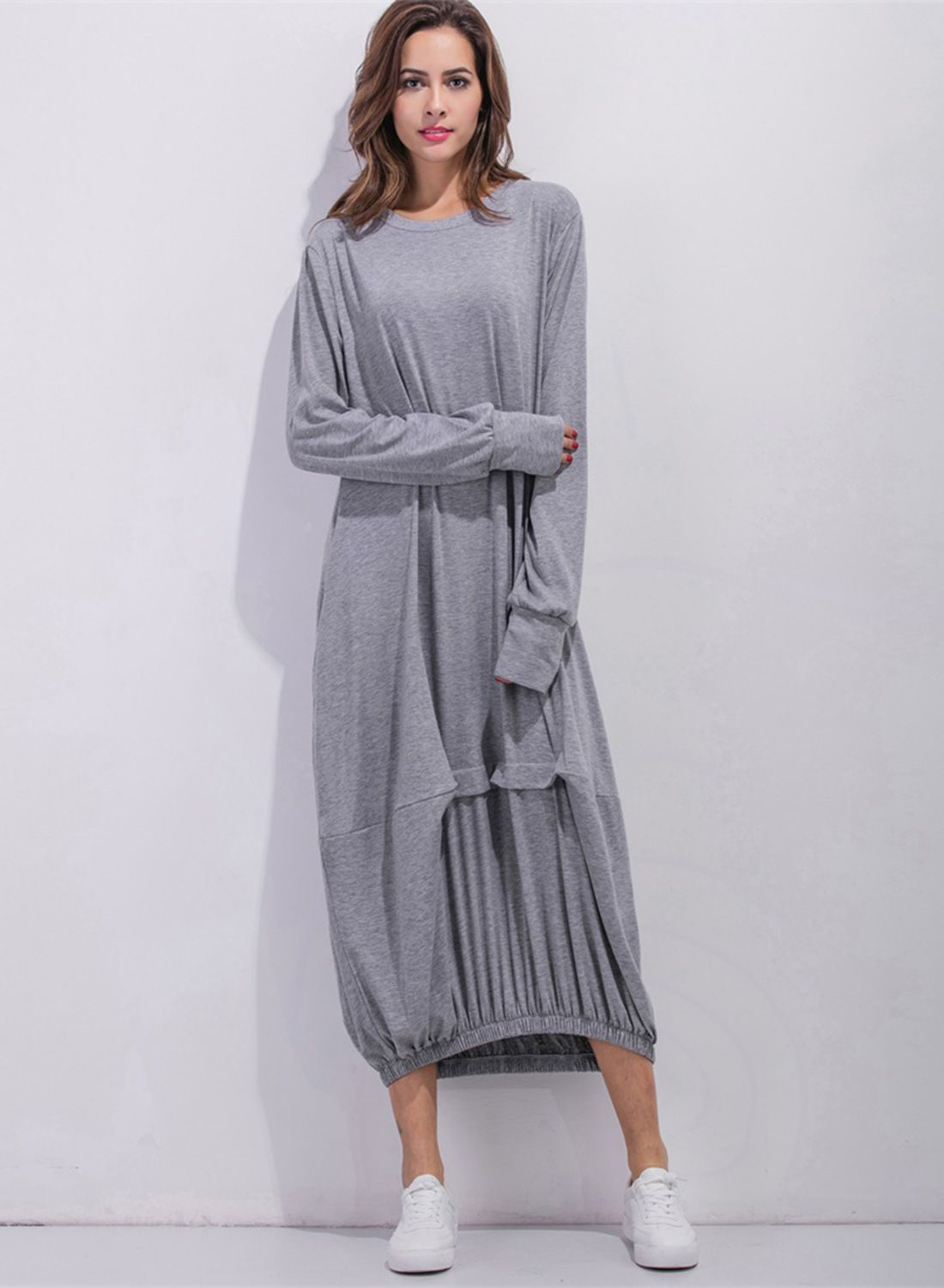 318621315d The dress is featuring round neck, pullover style, long sleeve, solid  color, loose fit and maxi length.
