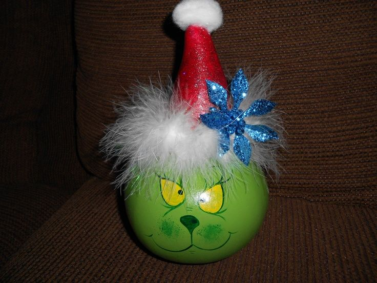 southwestern hand painted gourd ornaments   Hand painted dried gourd Mr. Grinch table ornament