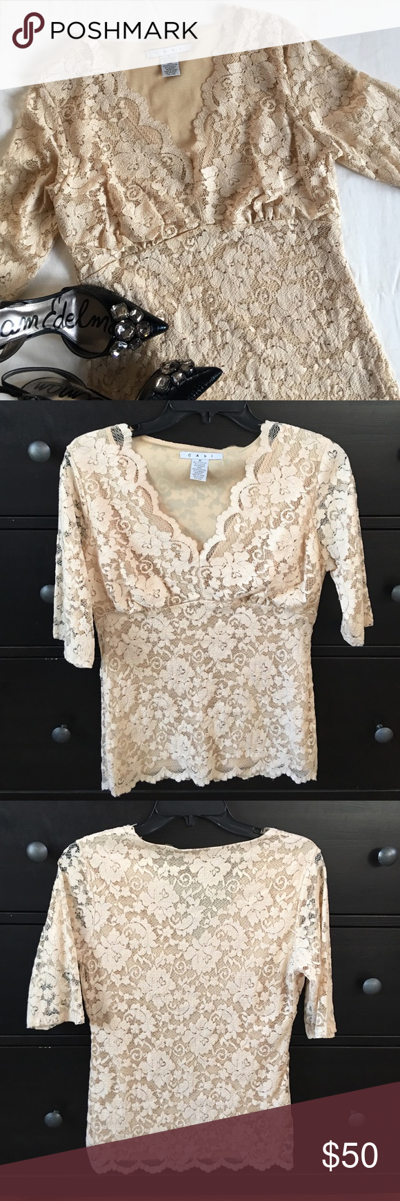 CAbi lace overlay top CAbi lace overlay top. Size medium. Excellent condition. Creamy beige over a beige lining. V neck. Elbow length sleeves. Gathering at bust with an empire type fit. Stretchy and form fitting. One loose thread on lining of neck (pictured), two small pulls in the lining, also in neck area and not noticeable when worn. Perfect under a blazer for work or with jeans for a night out. 61% nylon, 35% viscose, 4% spandex. Lining 100% polyester. CAbi Tops Blouses
