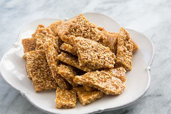 Sesame Brittle.  Such a yummy treat.  Made these and they turned out great!  It says to bring it up to 300º, but I went to 275º b/c it started to smell toasty.  It hardened just fine too.  Will def. make them again since everyone here likes it.