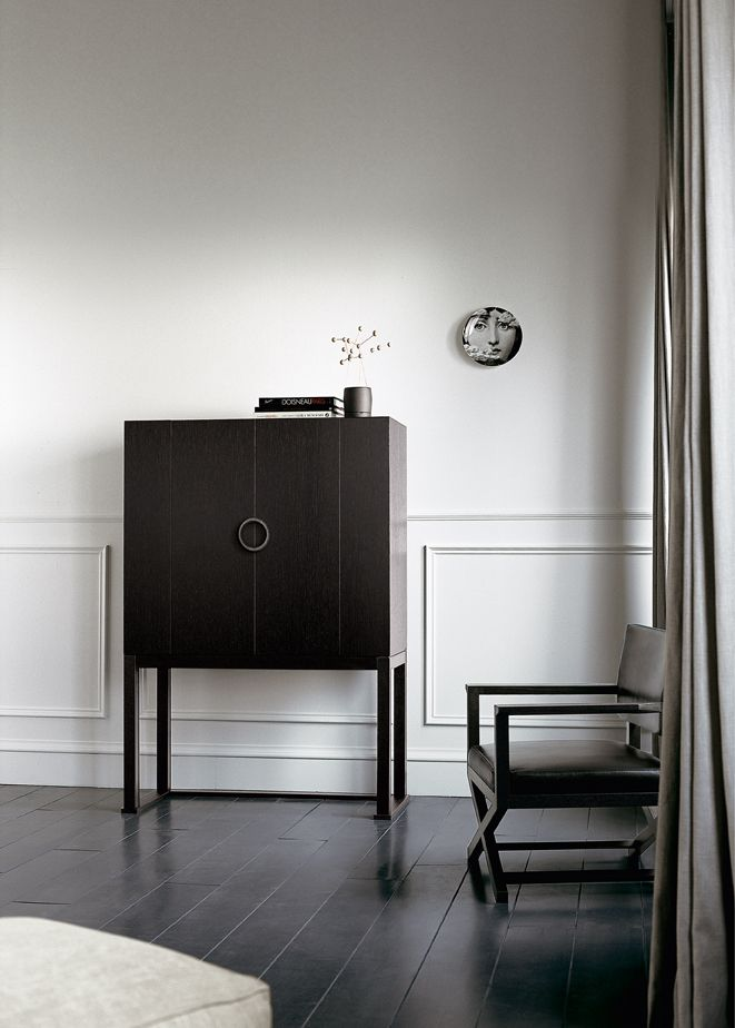 W 112 D 52 H 160 Oak wood cabinet. Base in solid oak wood.  Cast brass handle, wax patinated, dark bronze colour.  Taupe lacquered back panel. Finishing: oak stained to moka / ebony.
