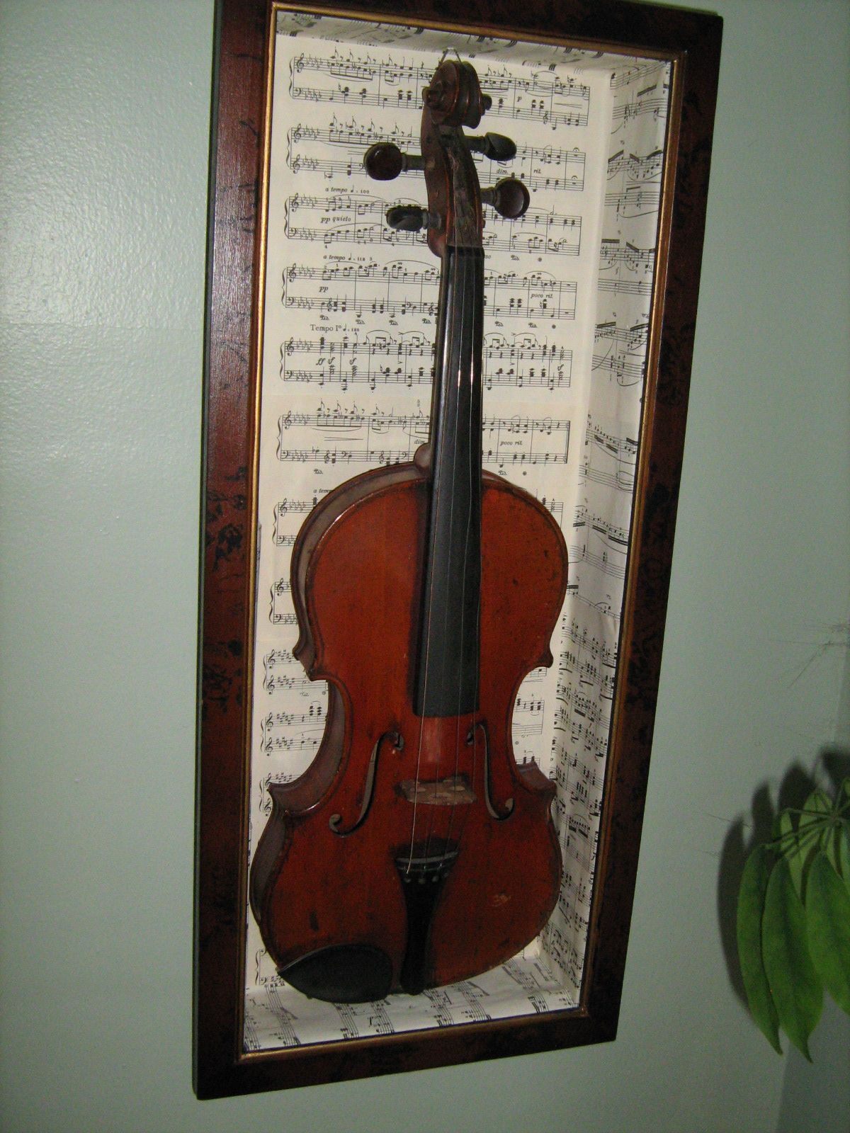This is how i repurposed old sheet music to cover a shadow for Violin decorating ideas