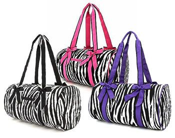 80752e46c5 Quilted Zebra Print Large Duffle Bag with Bows