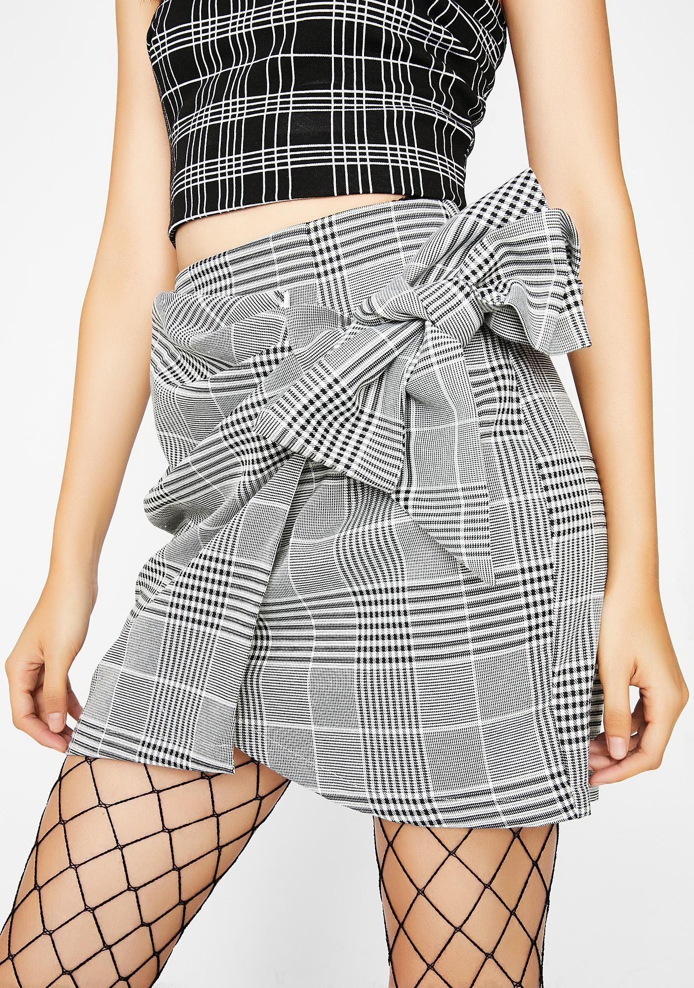 Cute babe in plaid skirt