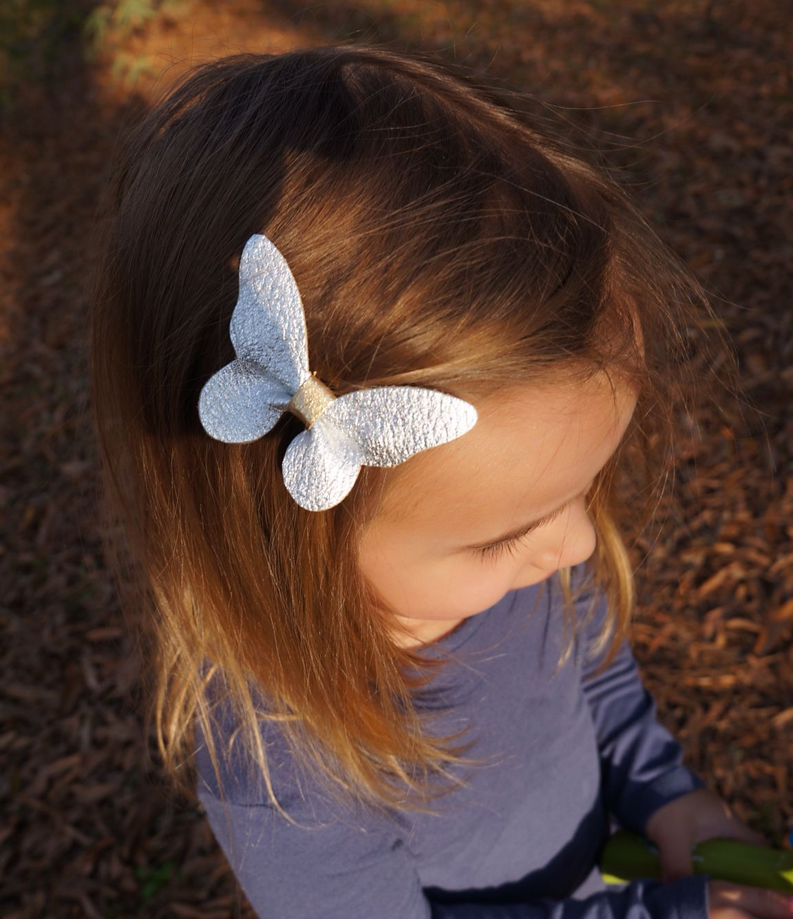 butterfly hair bow. silver leather