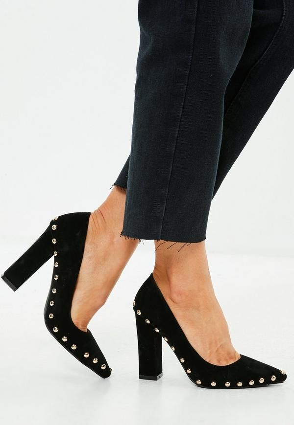 128dfeb0063 Black studded shoes with pointed toe and thick heel.
