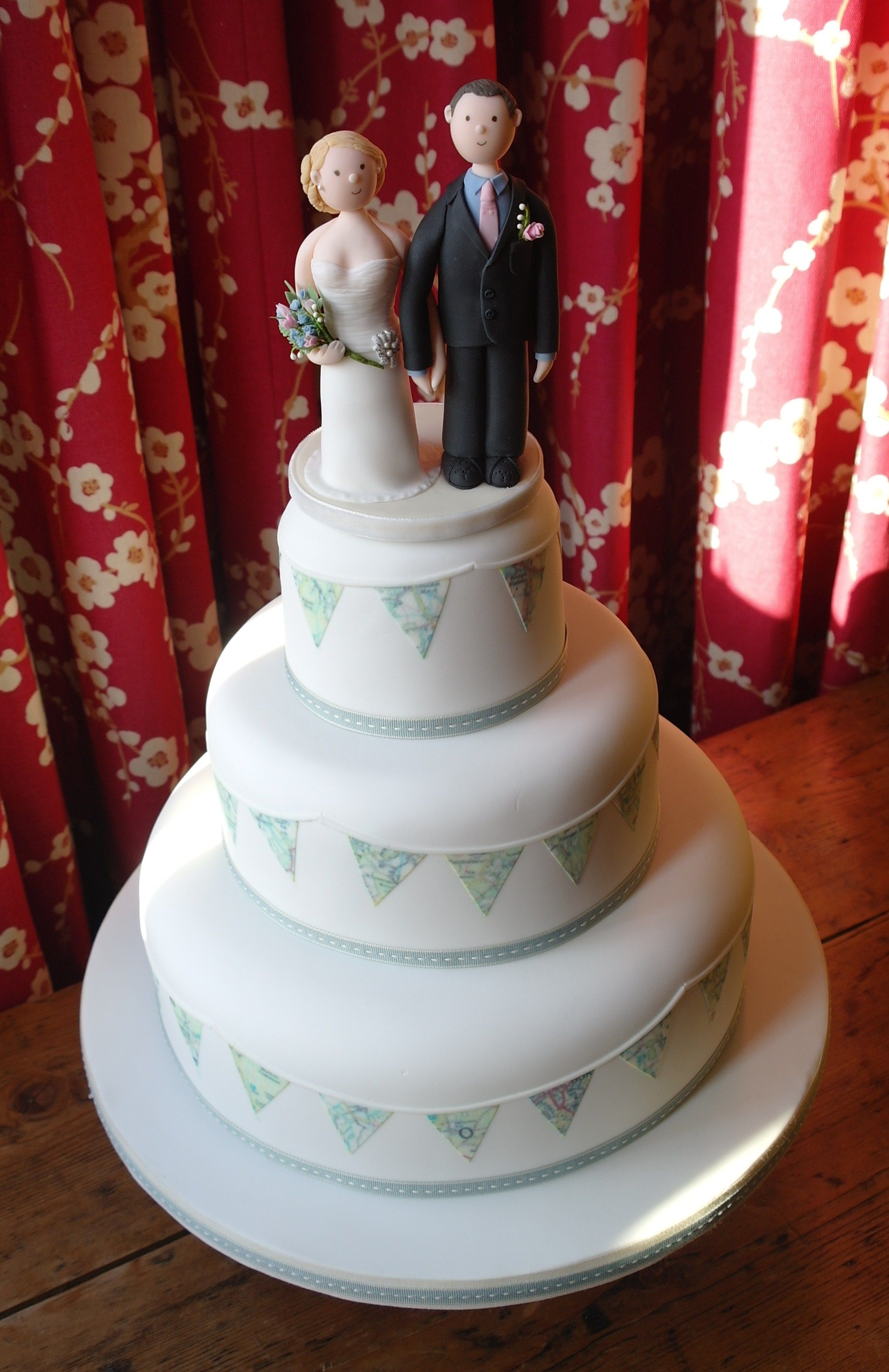 Three tier wedding cake with bunting side design made from local map