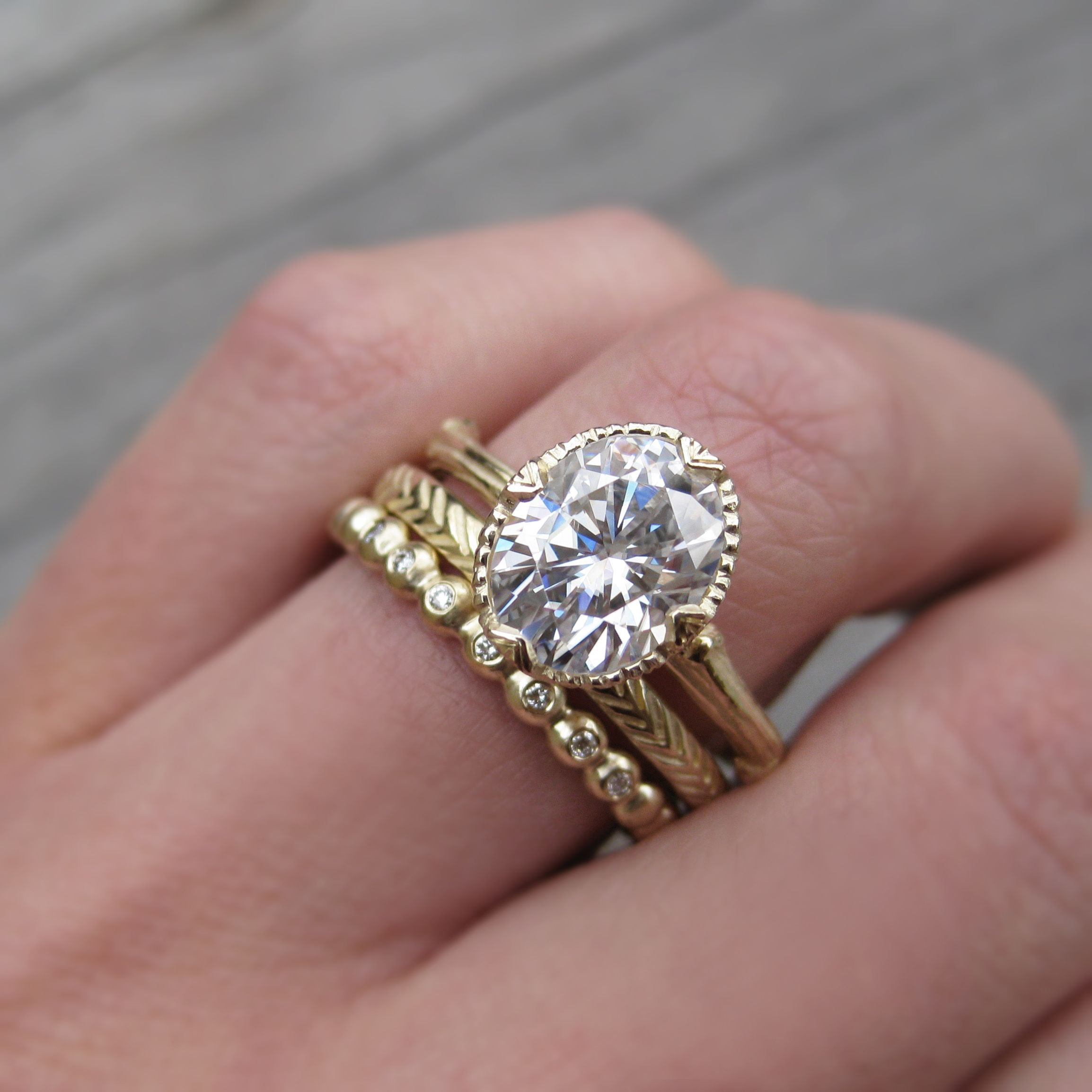 Forever one oval moissanite twig engagement ring with feather and